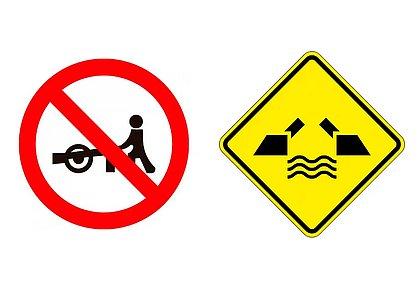 Algumas placas são menos comuns, como a que indica que é proibido o trânsito de carro de mão e a que alerta para a existência de uma ponte móvel