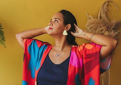 Isadora Alves, criadora daCom amor, Dora