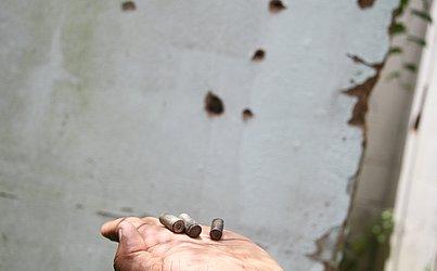 Cápsulas de bala encontradas no local